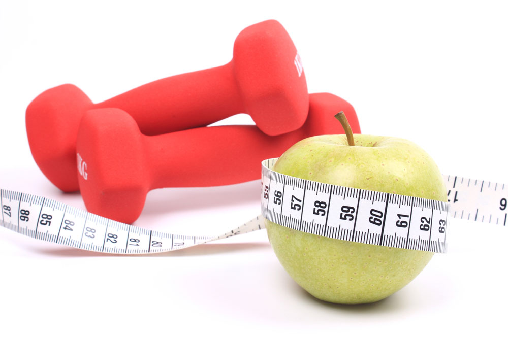 apple with tiny dumbbells
