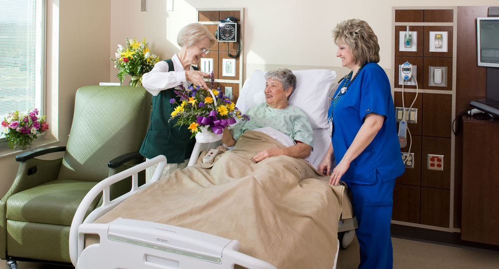 Leconte Medical Center volunteer and nurse in patient room