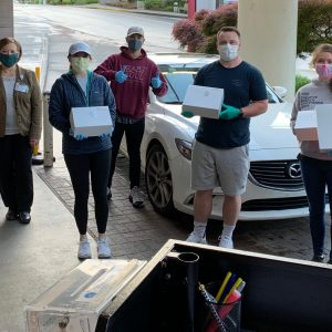 """The kind folks at HEART and SOUL Church delivered nearly 600 Pops Original Donuts to the Fort Sanders Regional team, along with some much needed mask """"ear savers."""""""